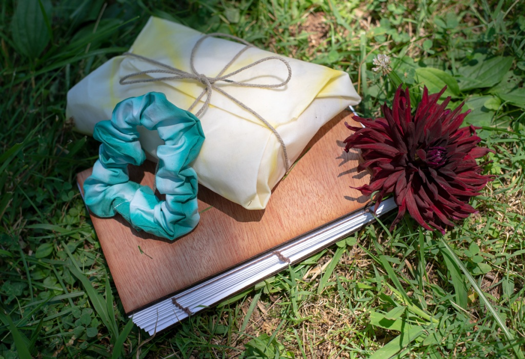 Items made in the Dyeing For A Picnic Class - a scrunchie, beeswax food wrap and a journal