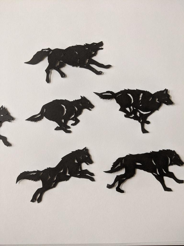 Paper cutout wolves